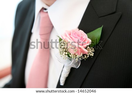 Image of beautiful pink rose on the groomâ??s suit - stock photo