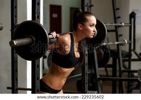 Image of beautiful slim girl lifting weight - stock photo