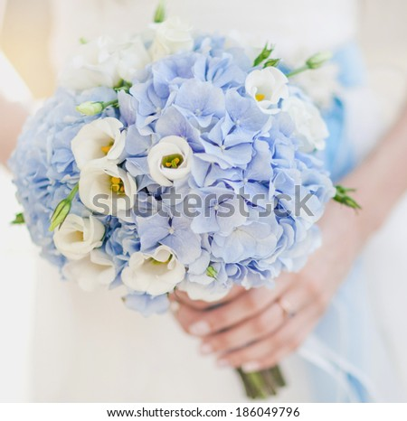 Image of beautiful wedding bouquet in blue tones - stock photo