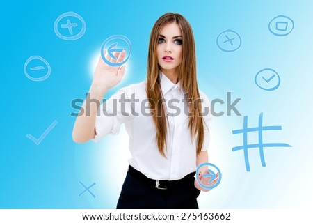 Image of beautiful young woman operating with virtual reality - stock photo