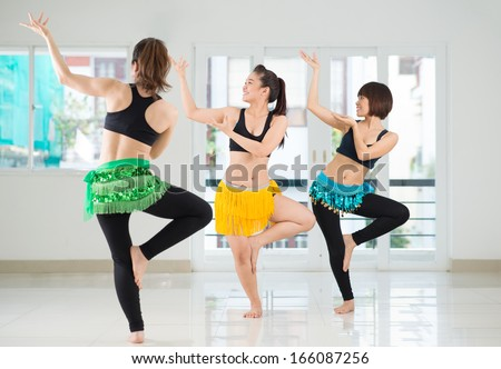Image of beauty belly dancers performing in the dance studio  - stock photo