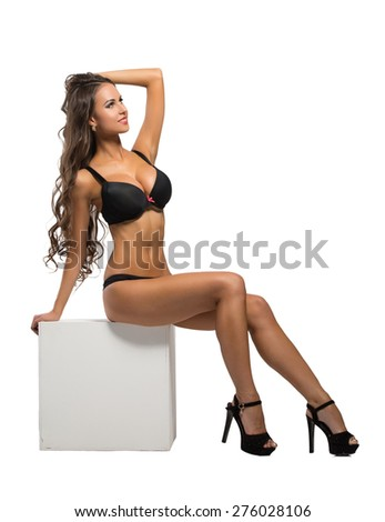 Image of beddable underwear model sitting on cube - stock photo