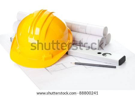 Image of  blueprints with level pencil and hard hat on table - stock photo