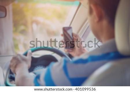 image of blur Concept of dangerousman used cell phone while driving are dangerous for other people,blur image - stock photo