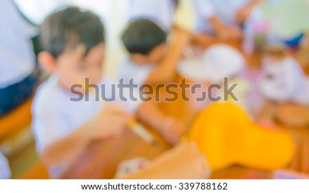image of blur kid drawing and painting on table in bright sunny playroom for background usage . - stock photo