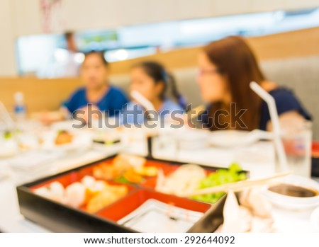 image of blur people at japanese restaurant .