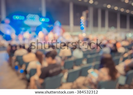 image of blur people in concert hall for background usage . - stock photo