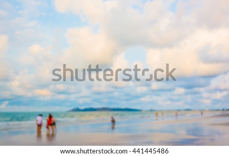 image of blur people walking on the beach for background usage . (minimalist)