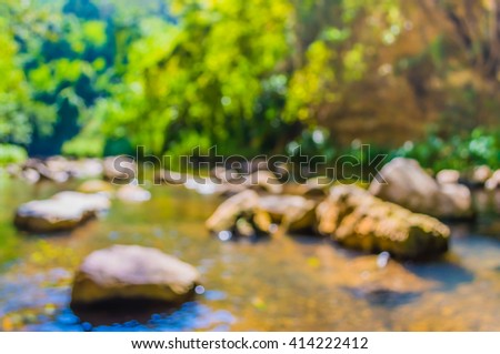 image of blur river and forest on day time for background usage . (vintage tone) - stock photo