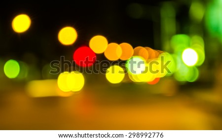image of blur street  bokeh  with green tone lights in night time for background usage . - stock photo