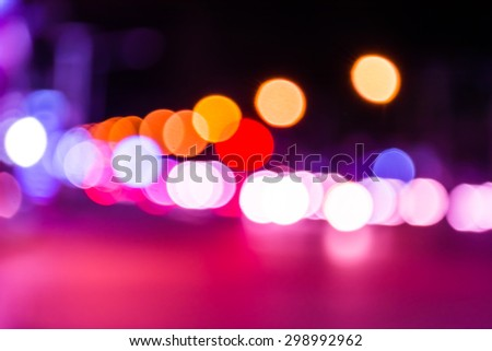 image of blur street  bokeh  with purple tone lights in night time for background usage . - stock photo