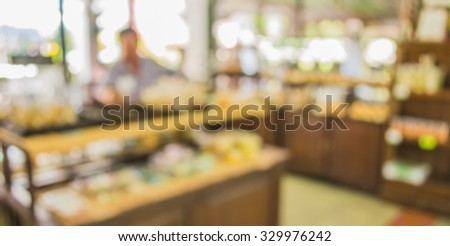 image of blurred bakery shelf in coffee shop for background usage . - stock photo