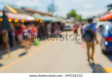 image of blurred day market on street with bokeh for background usage .
