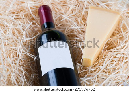 Image of Bottle of great wine with wineglass and cheese - stock photo