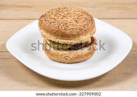 Image of burger on white plate wood background - stock photo