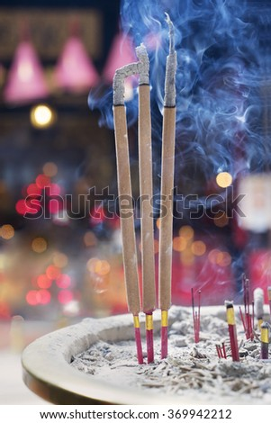 Image of burning incense sticks with smoke to pray in the temple - stock photo