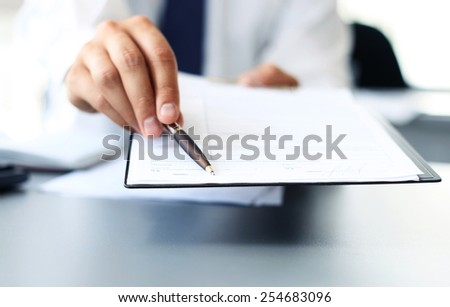 Image of business document being shown by female  - stock photo