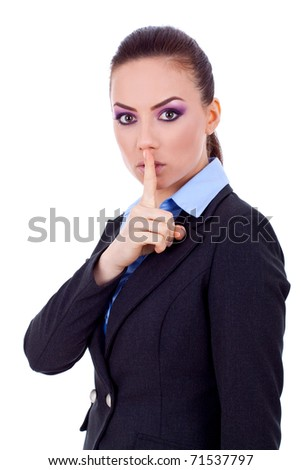 Image of business lady in suit holding her finger near the mouth - stock photo