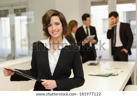 Image of business leader looking at camera in working environment  - stock photo