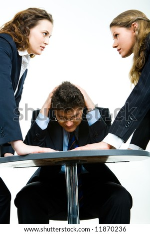 Image of business man fearing angry women - stock photo