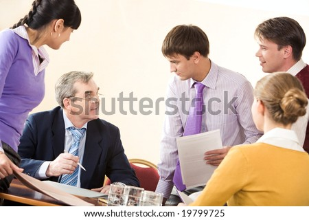 Image of business partners communicating at corporate meeting in office