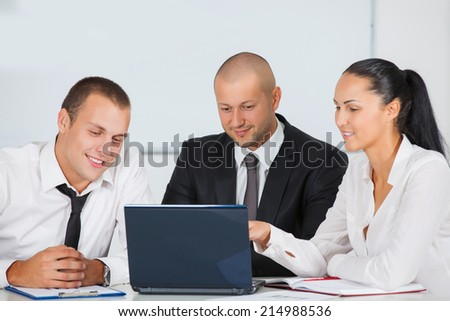 Image of business partners discussing documents and ideas at meeting in office - stock photo