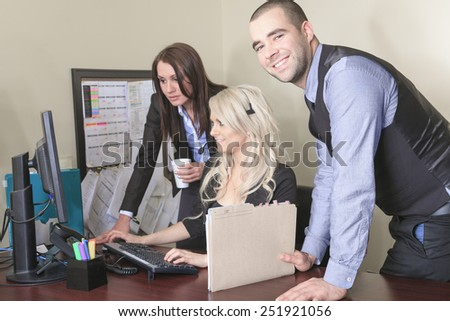 Image of business partners discussing documents and ideas at office