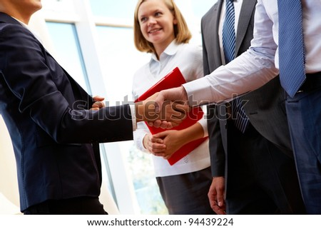 Image of business partners handshake after signing new contract - stock photo