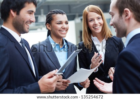 Image of business partners interacting at meeting - stock photo