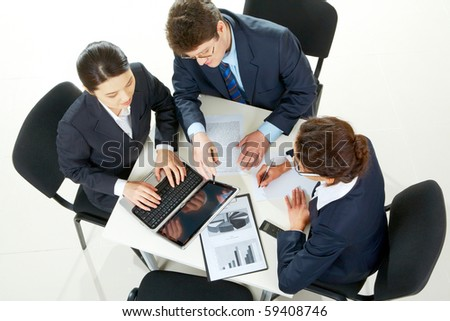 Image of business partners planning work at meeting