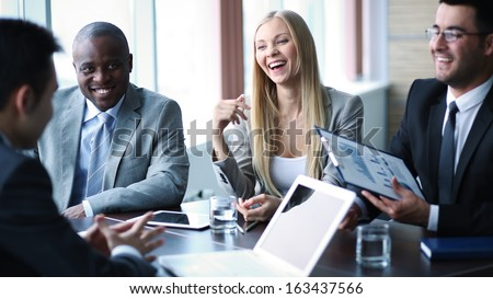 Image of business people communicating at meeting - stock photo