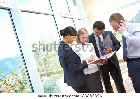 Image of business people consulting during paperwork - stock photo