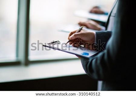 Image of business people discussing their ideas in office - stock photo