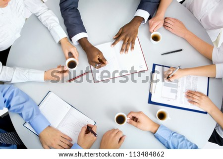 Image of business people hands working at meeting - stock photo