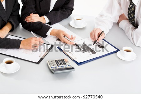 Image of business people hands working with documents at meeting - stock photo