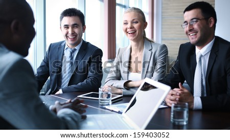 Image of business people interacting at meeting - stock photo
