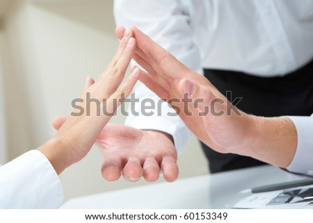 Image of business people palms opposite each other symbolizing support and unity - stock photo