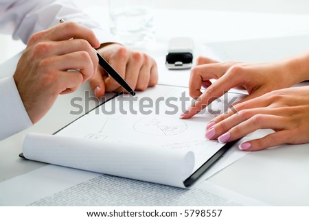 Image of business people's hands in a working environment - stock photo