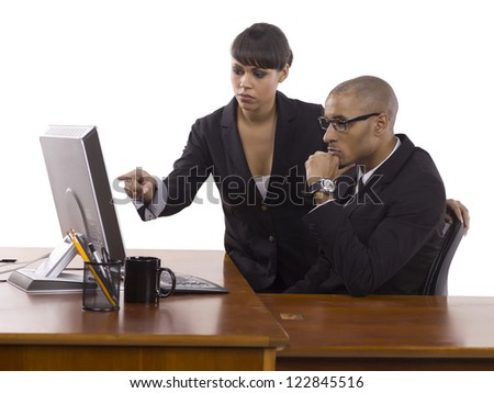 Image of business people seriously working at the office