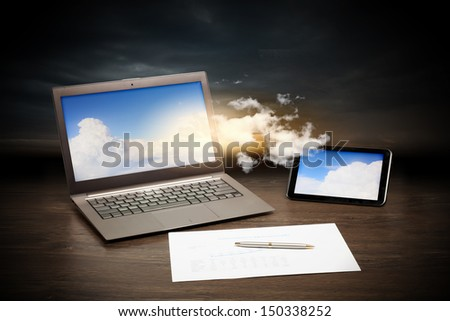 Image of business workplace with laptop, ipad, cup of coffee - stock photo