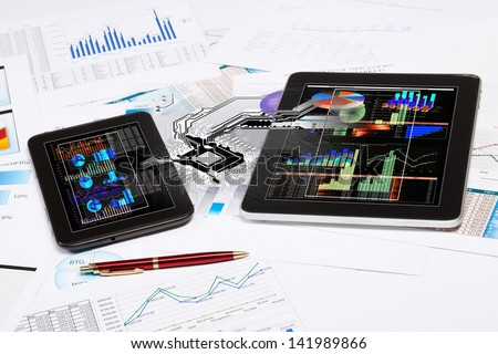 Image of business workplace with tablet pc and ipad - stock photo