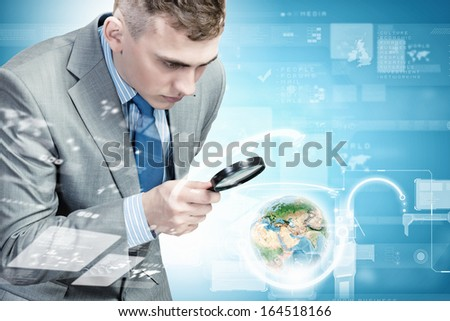 Image of businessman examining objects with magnifier.  - stock photo