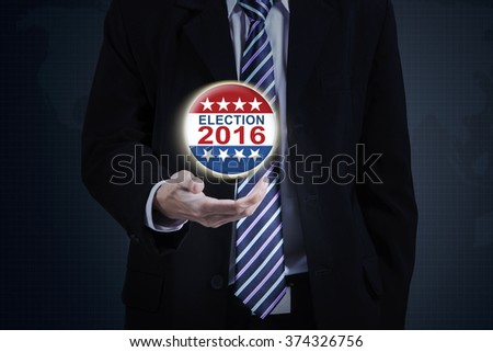 Image of businessman hand holding election symbol with number 2016 - stock photo