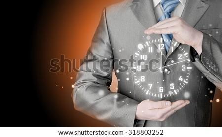 Image of businessman holding clock against illustration background - stock photo