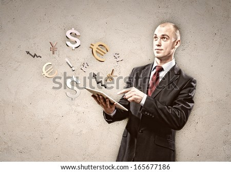 Image of businessman holding tablet pc. Finance concept - stock photo