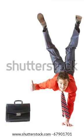 Image of businessman keeping himself on one arm while showing thumb up by another hand - stock photo