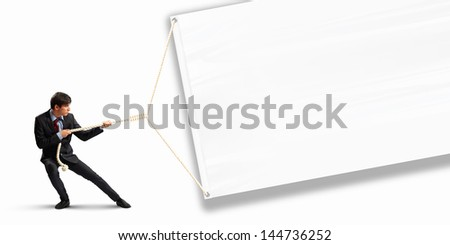 Image of businessman pulling blank banner. Place for text