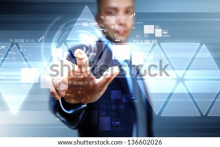 image of businessman touching screen with finger - stock photo