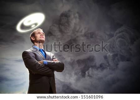 Image of businessman with halo above head - stock photo