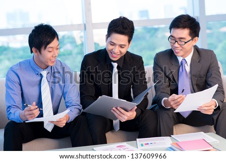 Image of businessmen discussing business plan - stock photo